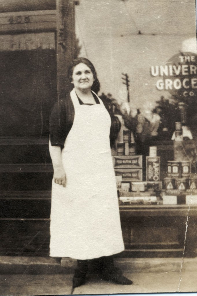Josephine Steinle Mackie in front of the Universal Grocery Store, Atwood at Division Street, circa 1920. Courtesy of the East Side History Club.