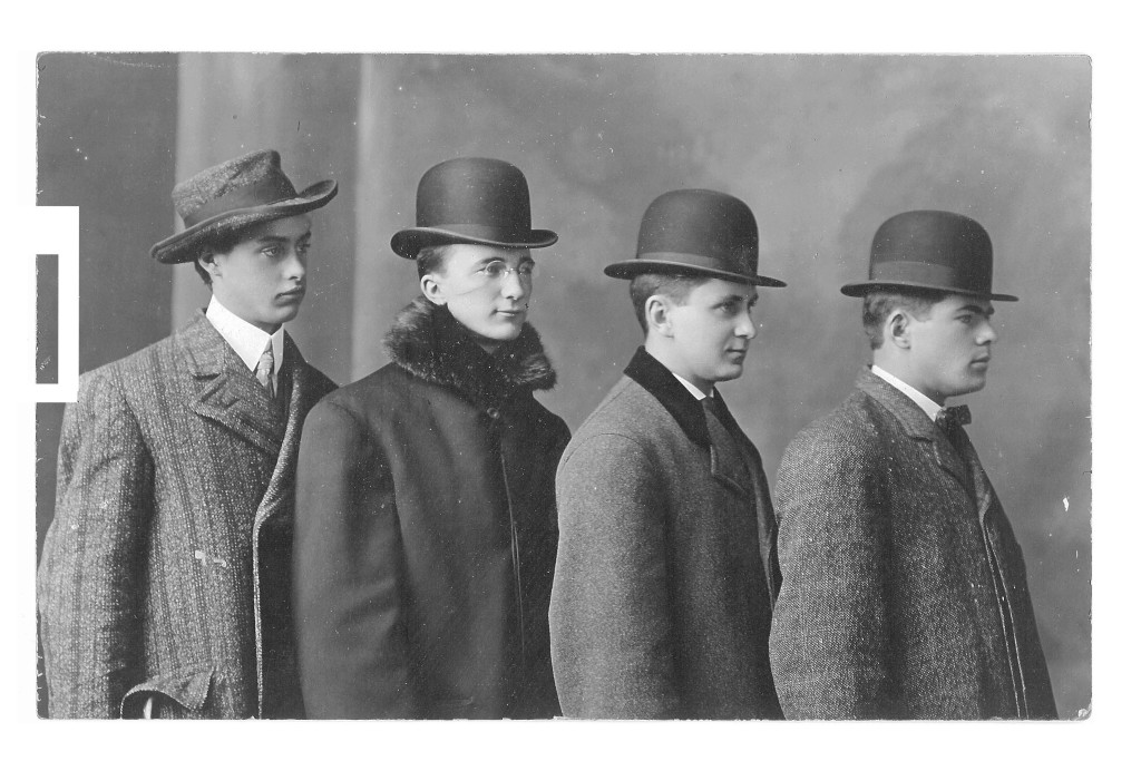 Four men wearing hats
