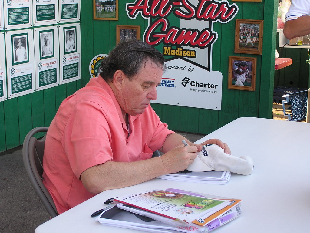 Jerry Mather signing a baseball cap at a Madison Mallard's game in 2008