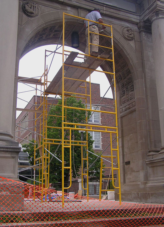 Stonemason and sculptor Jacob Arndt working on the restoration of the Central High School arch in October 2007